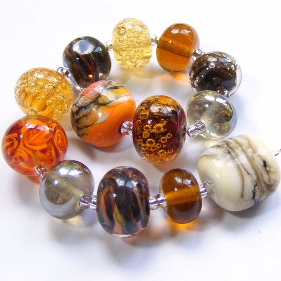 Handmade lampwork glass bead set of multicoloured 13 renegade beads - predominantly orange and brown  lampwork orphan beads