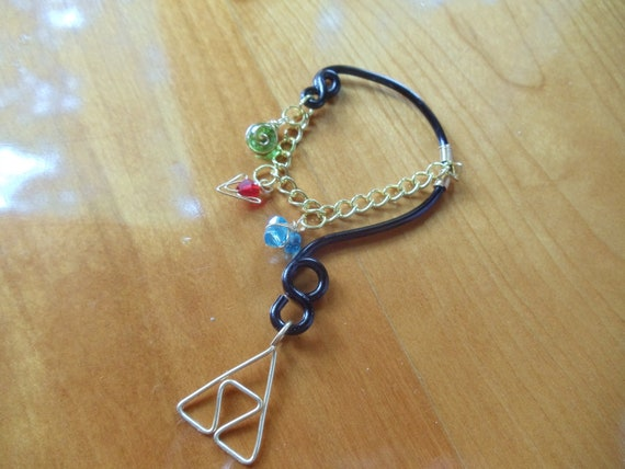 The Legend of Zelda's® Wise Ear Bend with Hanging Spiritual Stones and Triforce in Black