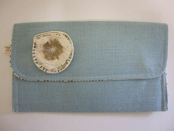 Soft Aqua blue Linen Clutch purse with fabric flower. Inside lining cream cotton with black typo