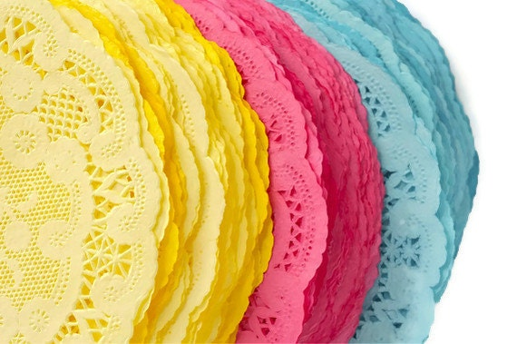 colored paper doilies With the look of lace and the convenience of paper, our gold round doilies are as pretty as they are practical use gold round doilies to line party platters and trays.
