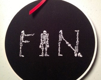 Fin. Hand Embroidered
