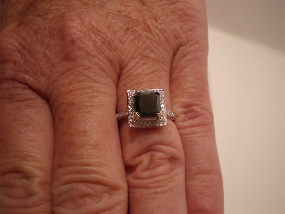 Black Diamond Engagement Ring On Hand