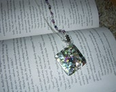 Albalone shell pendant with pretty seed beads.