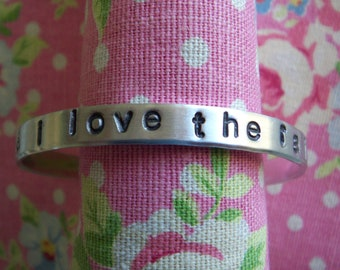 and (&) i love the rain... a hand stamped cuff