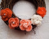 Large twiggy wreath/garland with crochet cotton pansies.