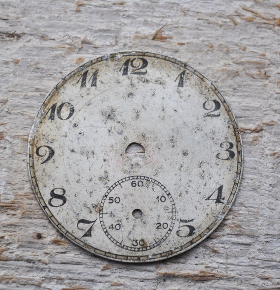 Antique pocket watch face.