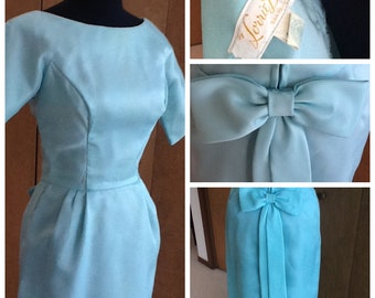 Stunning Turquoise Blue Part Dress with Long Bow by Lorrie Deb S M