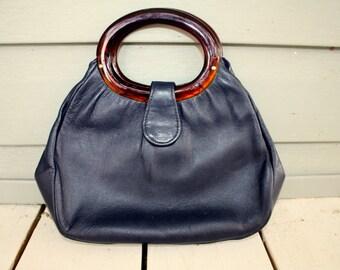 1970s Navy blue faux leather circle handle handbag