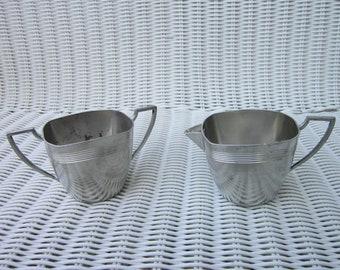 Antique Pewter sugar bowl and creamer