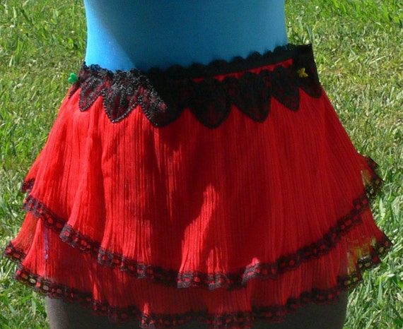 red sheer skirt size small trimmed in black lace