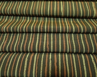 Casual stripes in golden brown tones on forest green Japanese silk.