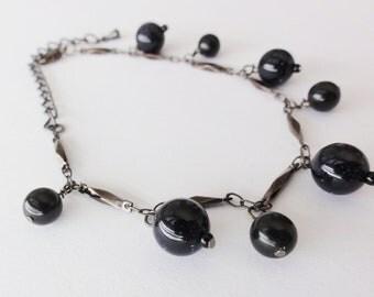 Goldstone and Onyx Dangle Bracelet