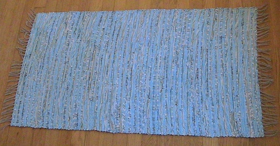 Handmade woven rag rug in shades of blue, gray, green and white