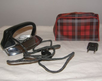 Travel Iron by Toeller with cloth cord.