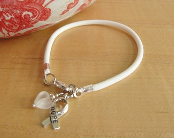 White Awareness Bracelet - Rubber - Blindness, Bone Cancer, Emphysema, Lung Cancer, Mesothelioma, Osteoporosis, PPD, Scoliosis