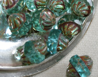 11 x 10mm . Czech Pressed Glass Etched Turbines .  crystal aqua picasso. 10 beads