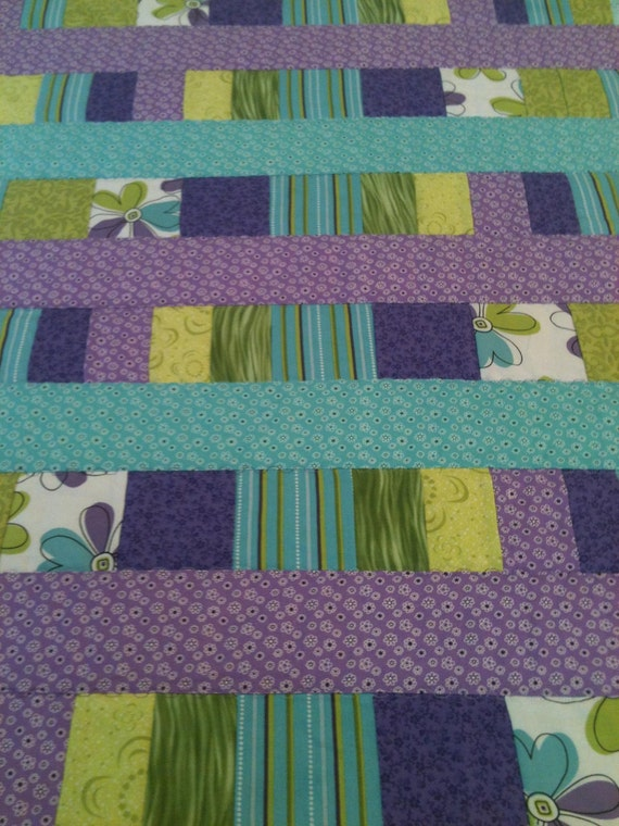 "Purple and Aqua In A Beautiful Blend Of What's Hot, In This 23"" X 28"" Baby Girl Quilt"