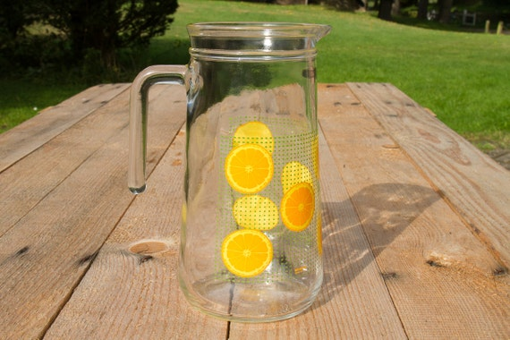 Vintage glass pitcher with oranges