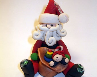 Polymer clay Christmas OrnamentChristmas ornament santa with a package of toysPolymer Clay  2016
