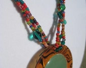 green and red beaded necklace with green stone and tiger print