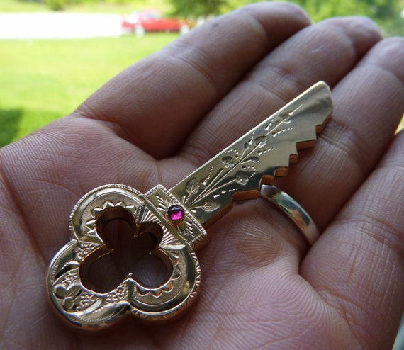 Rare Victorian rose gold Key with rose cut ruby stone