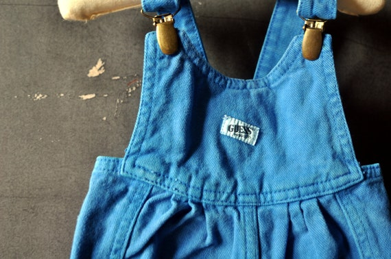 Totally rad blue blue denim Guess overalls with suspender clips, size 9 months, boy or girl
