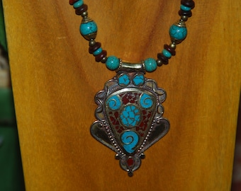Large Brass Tibetan Pendant surrounded by Turquoise, Horn Beads and Tibetan Brass Beads
