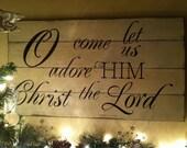 Christmas Sign on Barn Wood. O come let us adore Him Christ The Lord.