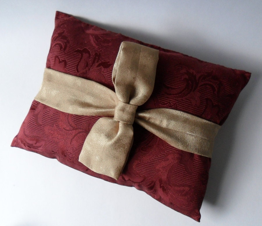 maroon brocade ring pillow with gold bow tie by