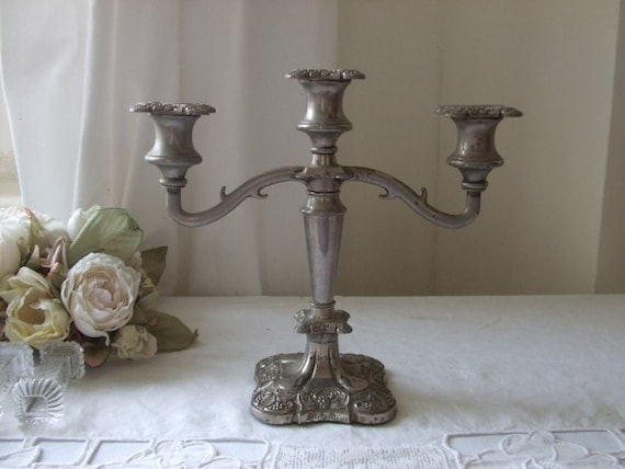 Vintage English heavy, silver plated  candelabra.  Found its way to France ......