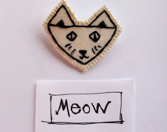 Embroidered cat brooch in black and white with sparkle eyes and whiskers children's jewelry