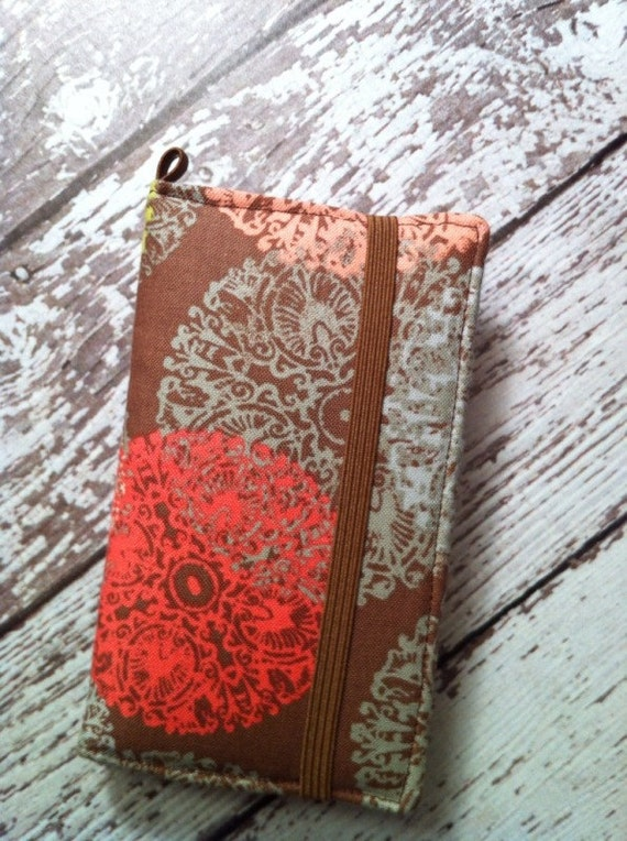Brown with muted pastel medallions iPhone wallet case with removable gel case