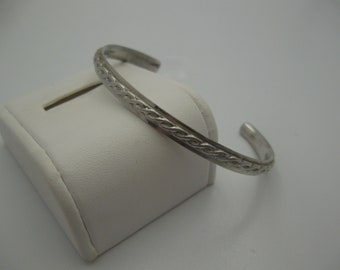 sterling silver twisted patterned cuff braclet.