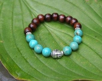 Yogi inspired wood bead bracelet with silver Buddha head bead and turquoise beads