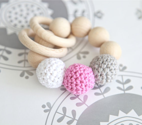 Teething toy with crochet wooden beads and 2 wooden rings. Light grey, pink, white wooden beads rattle.
