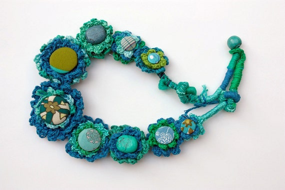 Blue crochet necklace with stones and fabric buttons