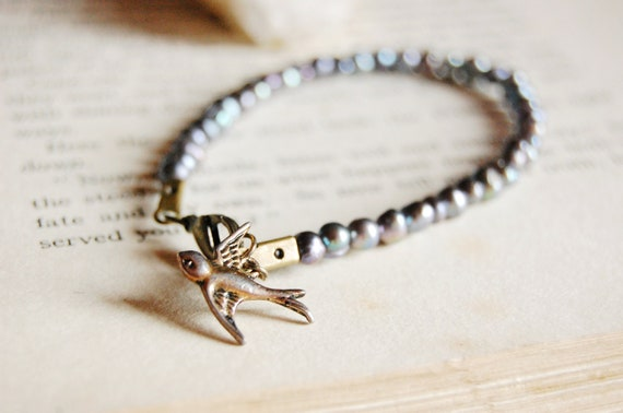 Little life. Beautiful blue fresh water pearl bracelet with tiny brass bird charm.