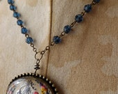 Les Miserables Goofus Brooch Multi Color Flower on a Blue Beaded Rosary Chain