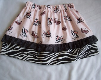 Ready to ship girls size 4/5 skirt with elastic waist, ruffle and cute zebra and leopard butterfly print fabric.