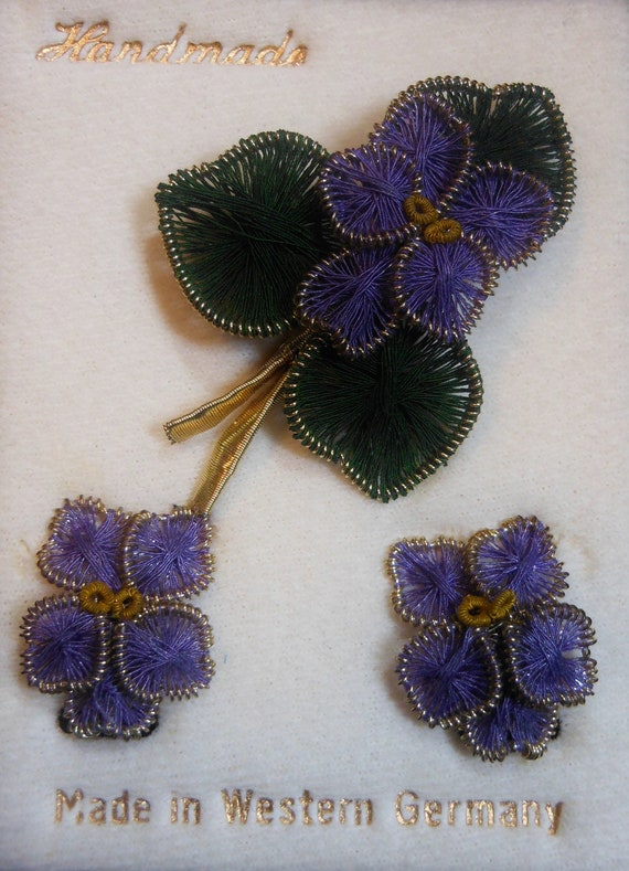 Rare handmade 1940s 1950s wire spun West Germany purple floral brooch and earrings on card with green leaves and gold trim