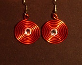 Red spiral earrings with clear crystal elements