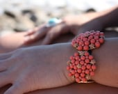 RESERVED Mayflower bracelet -- gold tone & coral enamel flower bracelet
