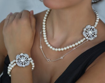 Amilla Romantic Swarovski crystal and pearl bridal necklace and bracelet set.