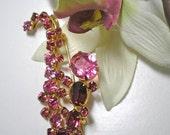 Vintage Pink & Purple Rhinestone Saxophone Brooch   Item No: 15774