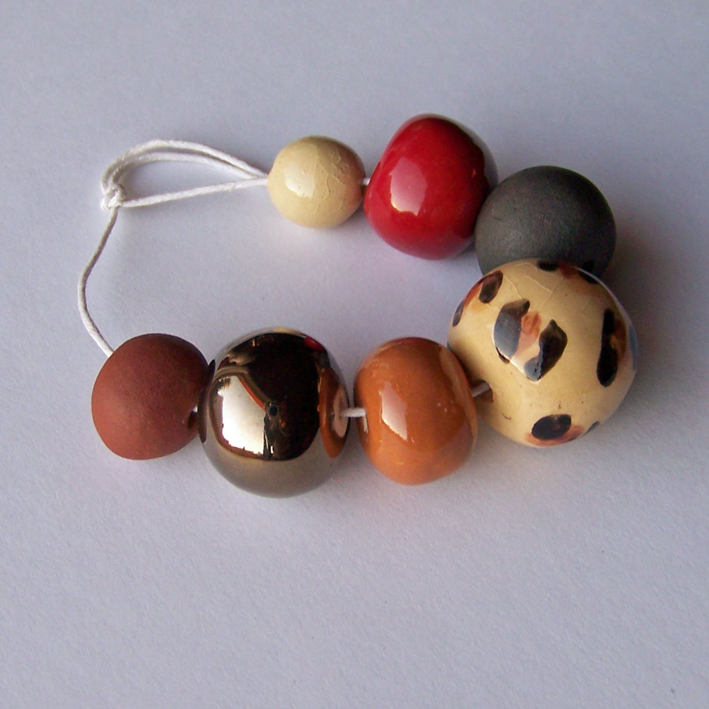 handmade ceramic bead set by earthbutterstudio