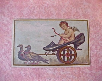 Darling Victorian Lithograph Scrap of Cherub Driving A Sulky with a Ladies Slipper for a Seat