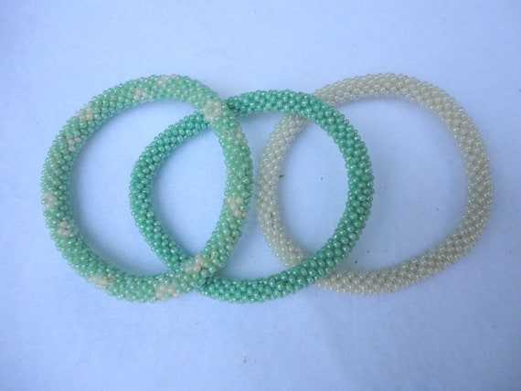Set of three crocheted beaded bracelets -mint green and eggshell white beaded bracelet,Nepal roll on bracelets, fall 2012 collection