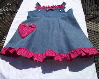 little girls recycled denim jumper, with heart pocket, trimmed in pink leopard spots