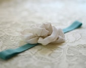 white and gold fabric flower on teal headband--eco friendly fashion