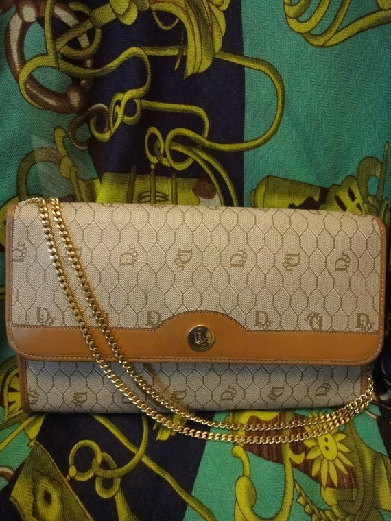 Vintage Christian Dior Vintage beige purse with CD charm and gold tone chains.